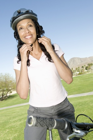 Woman adjust cycling helmet Stock Photo - 12735661