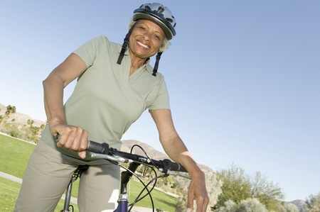 mountainbike: Senior woman sits on mountainbike