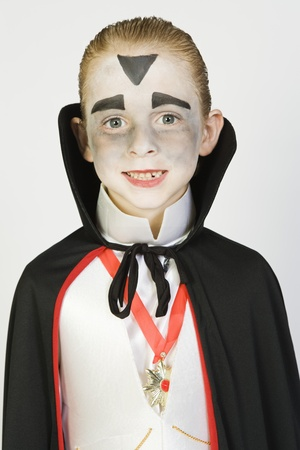 dressing up costume: Portrait of boy (7-9) wearing dracula costume for Halloween