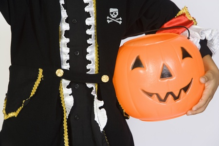 jackolantern: Boy (7-9) wearing Halloween costume with jack-o-lantern
