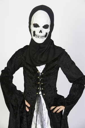 Portrait of child (7-9) wearing skeleton costume Stock Photo - 12737695