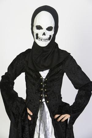 Portrait of child (7-9) wearing skeleton costume Stock Photo - 12737695