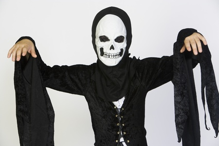 Portrait of child (7-9) wearing skeleton costume Stock Photo - 12737696