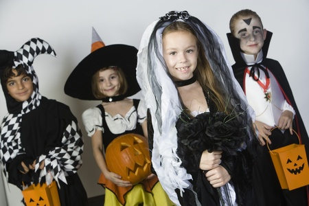 Portrait of boys and girls (7-9) wearing Halloween costumes Stock Photo - 12737705