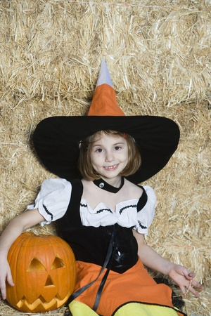Portrait of girl (7-9) wearing witch costume by hay Stock Photo - 12737706