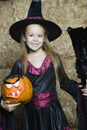 Portrait of girl (7-9) wearing witch costume by hay Stock Photo - 12737709