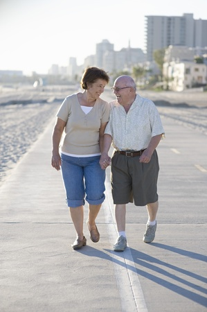 Senior couple on footpath along beach Stock Photo - 12735456