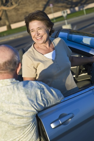 Senior couple standing outside convertible elevated view Stock Photo - 12737755