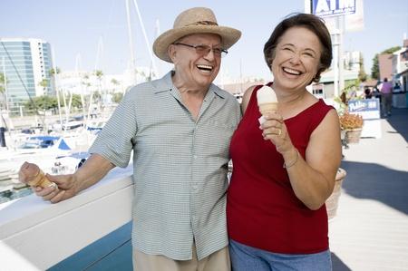 Senior couple holding ice creams Stock Photo - 12737769