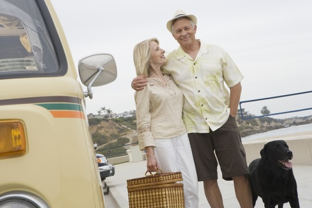 Senior couple stand on beach promenade with campervan Stock Photo - 12735352