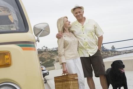 Senior couple stand on beach promenade with campervan Stock Photo - 12735352