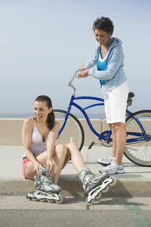 Mature and mid adult woman prepare for exercise Stock Photo - 12737772