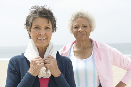 Two senior women stand on coastal promenade Stock Photo - 12735439