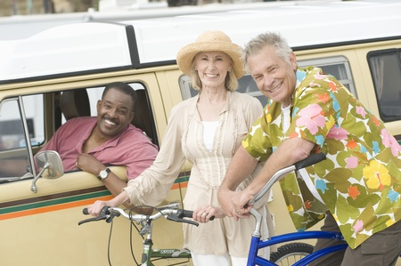 Senior couple stand with bikes next to campervan driven by mature man Stock Photo - 12735426