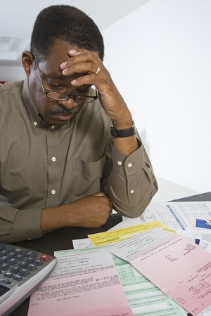 difficulties: Senior Man Worrying About Home Finances
