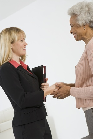 Senior Woman Meeting Financial Advisor Stock Photo - 12735401