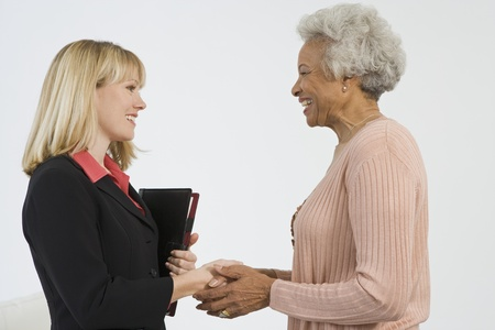 financial advisor: Senior Woman Meeting Financial Advisor