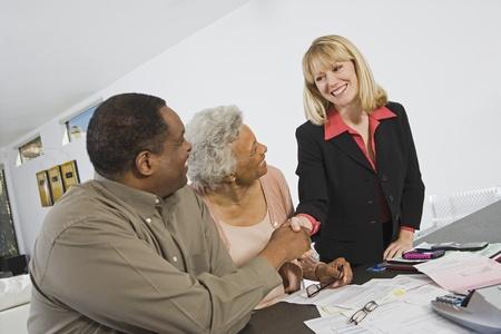 Senior Couple Meeting Financial Advisor Stock Photo - 12735397