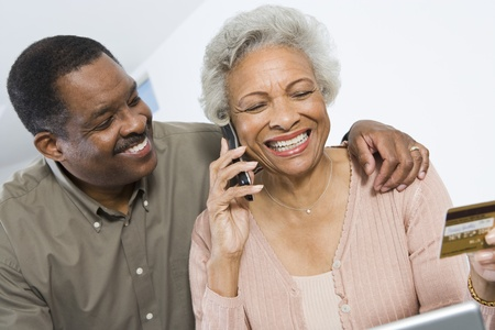 Cheerful Senior Couple Managing Home Finances Stock Photo - 12735387