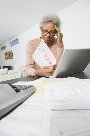 Senior Woman Worrying About Home Finances Stock Photo - 12735384