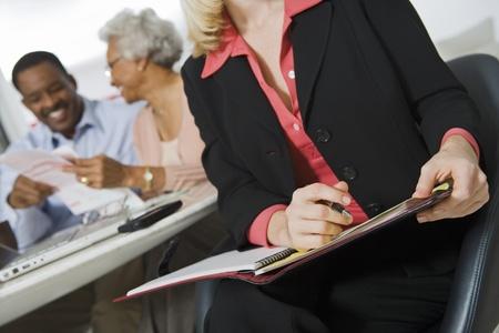 Financial Advisor Assisting Senior Couple Stock Photo - 12735381