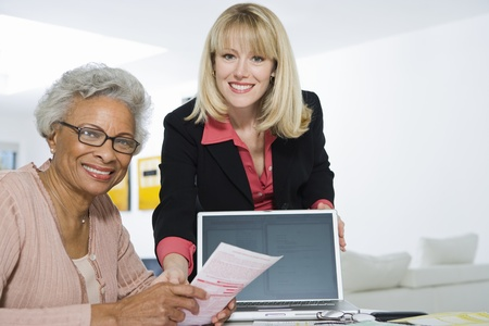 Financial Advisor Assisting Senior Woman Stock Photo - 12735383