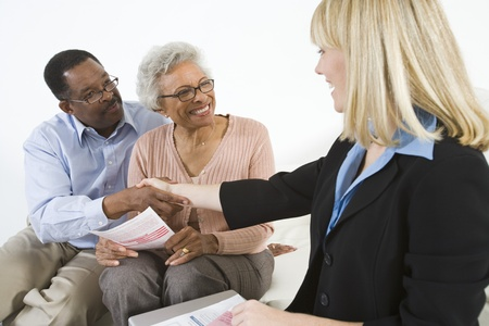 Financial Advisor Assisting Senior Couple Stock Photo - 12735366