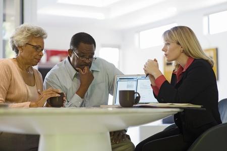Financial Advisor Assisting Senior Couple Stock Photo - 12735358