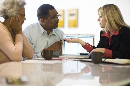advising: Financial Advisor Assisting Senior Couple