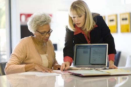 Financial Advisor Assisting Senior Woman Stock Photo - 12735360