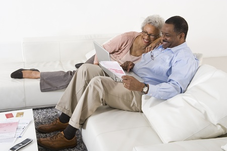 Cheerful Senior Couple Using Laptop Stock Photo - 12735356