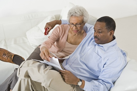 african american couple: Senior Couple With Paperwork
