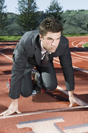 Businessman At Starting Blocks Stock Photo - 12735369