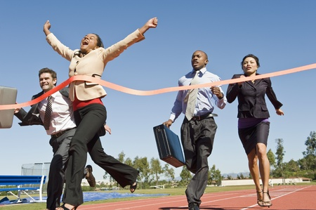 sexes: Business People Crossing the Winning Line LANG_EVOIMAGES