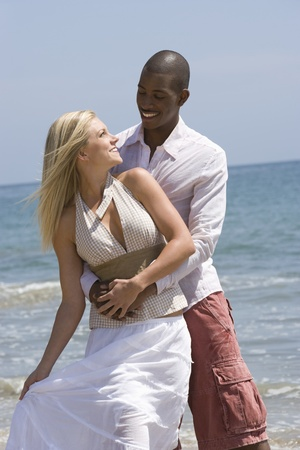 Couple embracing on beach Stock Photo - 12735435