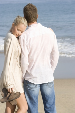 Couple walking on beach Stock Photo - 12737778