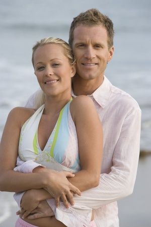 Couple embracing at the beach Stock Photo - 12737780