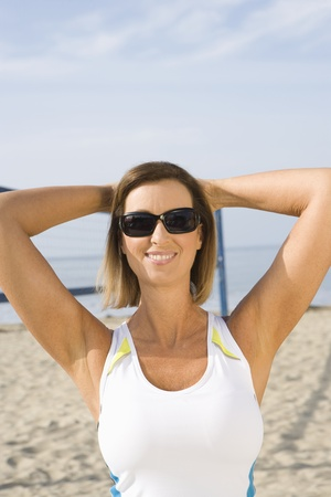 Sporty woman at the beach Stock Photo - 12737782