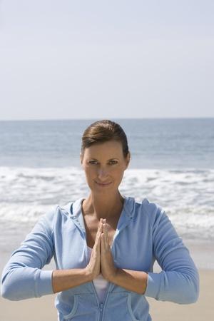 Woman exercising at beach Stock Photo - 12737789