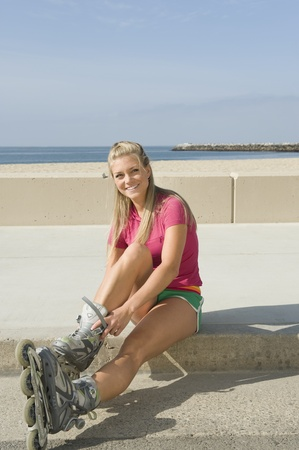 Young woman wearing rollerblades Stock Photo - 12737798
