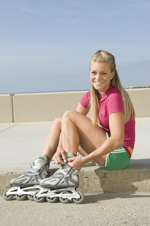 Young woman wearing rollerblades Stock Photo - 12737799