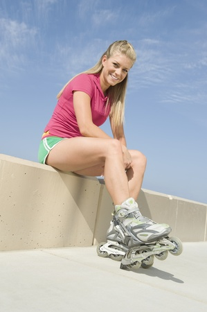 Young woman wearing rollerblades Stock Photo - 12737800
