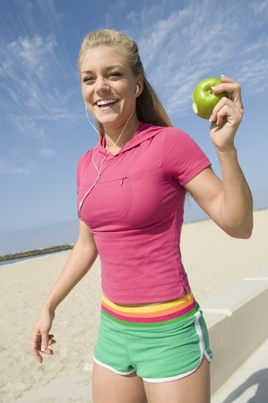 Young woman holding apple Stock Photo - 12737802
