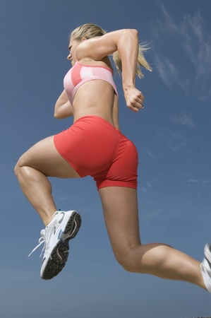 running pants: Woman jogging low angle