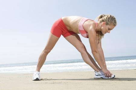 Woman exercising at beach Stock Photo - 12737807