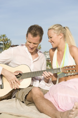 Couple with guitar Stock Photo - 12737828