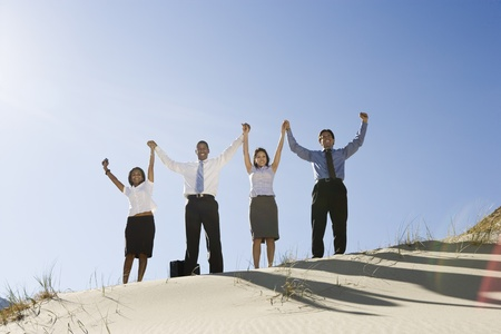 Business People Cheering in the Desert Stock Photo - 12735255
