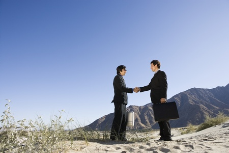 Two Businessmen Shaking Hands in the Desert Stock Photo - 12735251