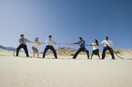 pull out: Business People Playing Tug of war in the Desert