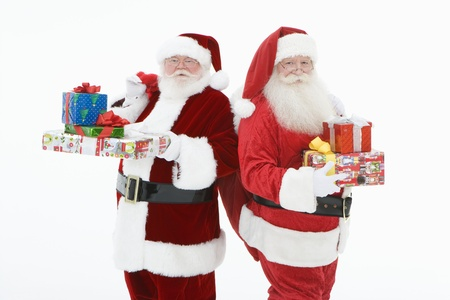 Two men dressed as Santa Claus holding gifts Stock Photo - 12735098